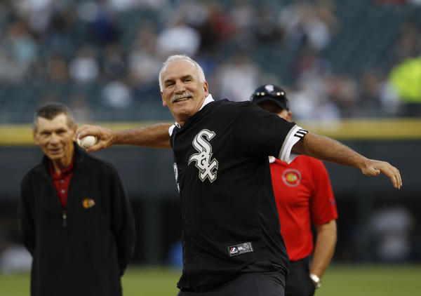 Blackhawks coach Joel Quenneville throws out the ceremonial first pitch before a game in 2012.