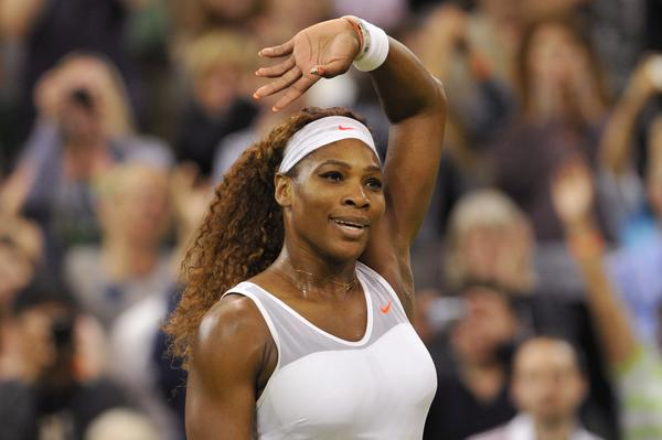 Serena Williams celebrates beating Kimiko Date-Krumm in their third round match.