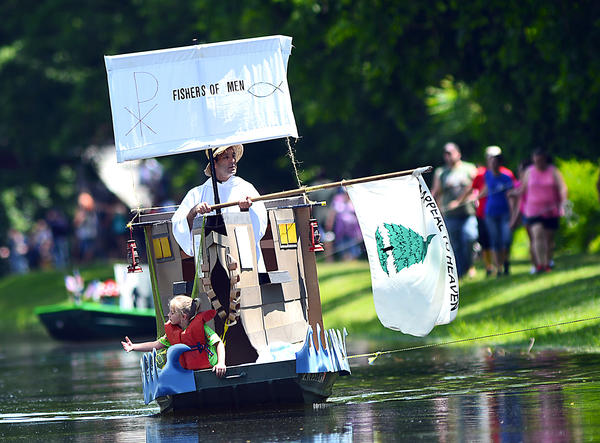The Rev. Jack Lombardi moves his barge forward with Philomena Tiller in the bow Saturday at Hancock's 11th annual Barge Bash at Chesapeake & Ohio Canal National Historical Park.