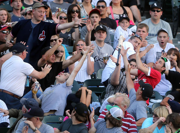 Fans reach for Tyler Flowers' bat as it flies into the stands in the fifth inning on Saturday.