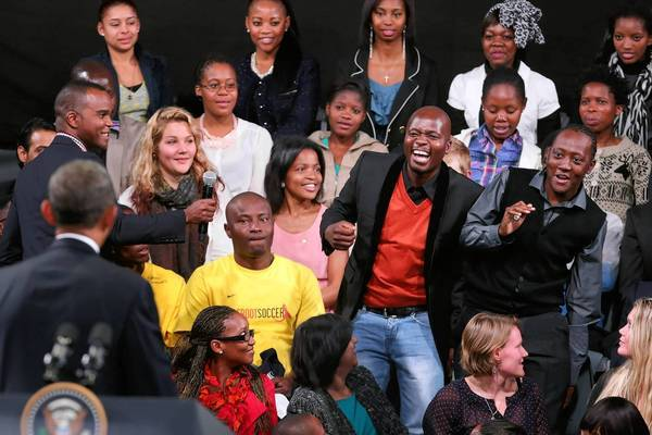 A member of the audience reacts as President Obama calls on him to ask a question during a town hall meeting at the University of Johannesburg in South Africa.