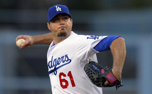 Dodgers starter Josh Beckett is scheduled to undergo season-ending surgery on his throwing hand the week of July 8.