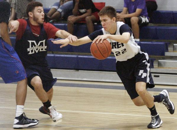 Flintridge Prep's Robert Cartwright, right, scored a game-high 31 points in a 62-41 loss to Maranatha.