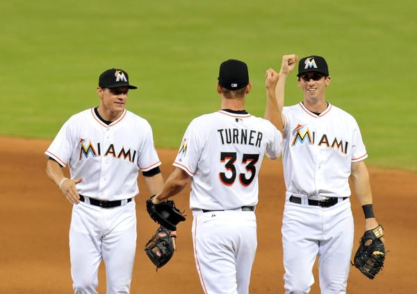 Jun 29, 2013; Miami, FL, USA; Miami Marlins starting pitcher Jacob Turner (center) greets second baseman Derek Dietrich (left) and first baseman baseman Ed Lucas (right) after defeating the San Diego Padres 7-1 at Marlins Park. Mandatory Credit: Steve Mitchell-USA TODAY Sports ORG XMIT: USATSI-122736