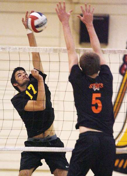 ARCHIVE PHOTO: La Cañada High's Orion Burl, left, is an All-Area Boys' Volleyball second-team selection.