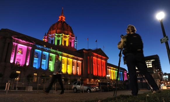 San Francisco City Hall is lit up in rainbow colors the night before the city's gay pride parade.