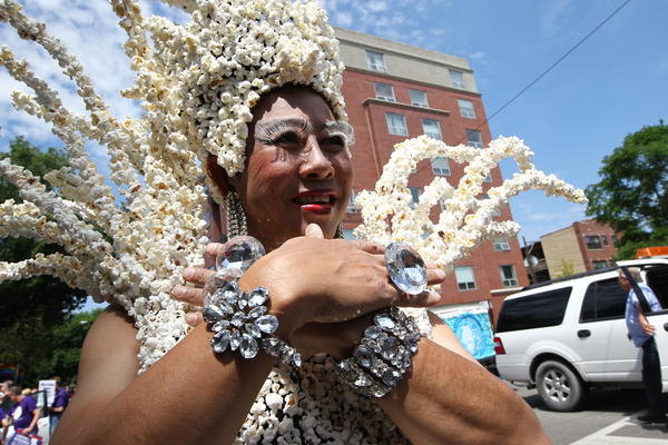 Kevin Vong, with the group Asians and Friends of Chicago, wears a dress made of popcorn before the start at Chicago's Pride Parade at Broadway and Montrose avenues on Sunday.