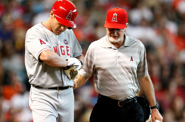 Angels center fielder Peter Bourjos checks his right wrist after getting hit by a pitch.