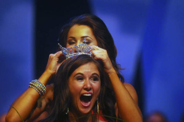 Brittany Smith of Elmhurst, Ill. reacts after being crowned Miss Illinois 2013 by Megan Ervin, who was Miss Illinois 2012 at the Marion Cultural & Civic Center in Marion, Ill. on Saturday.