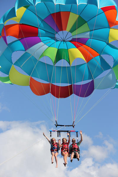 Boyne Parasail offers tandem trips for up to three people on both Lake Charlevoix and Little Traverse Bay.