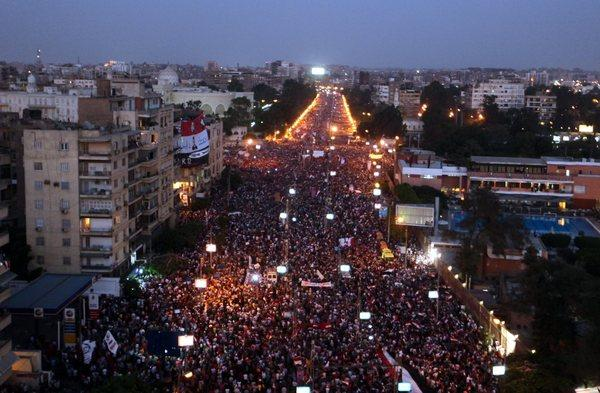 Protesters opposed to President Morsi demonstrate in front of the presidential palace in Cairo on Sunday.