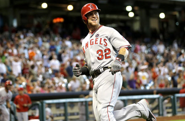 Angels right fielder Josh Hamilton reacts after doubling and coming all the way home on the play in the eighth inning Sunday in Houston.