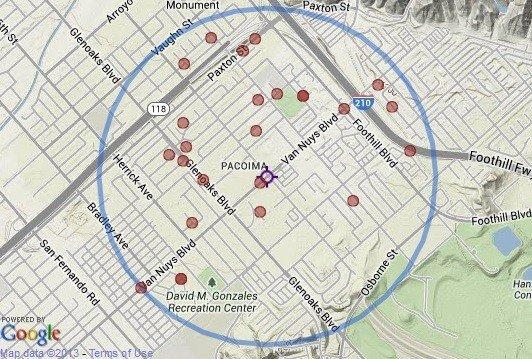 The purple marker shows the location of a fatal officer-involved shooting in Pacoima on Sunday. The red markers indicate 25 homicides within one mile of the location since 2007.