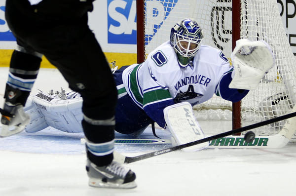 Canucks goaltender Cory Schneider makes a stop against the San Jose Sharks' Brent Burns in the second period of Game 4 of the Western Conference quarterfinal. Schneider was traded to the Devils on Sunday.
