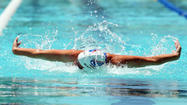 Magnuson wins 50-meter butterfly