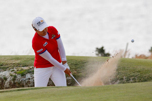 Inbee Park hits out of a bunker on the 18th green during the third round of the U.S. Women's Open at Sebonack Golf Course.