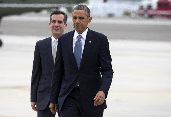 President Obama walks with Los Angeles Mayor-elect Eric Garcetti after arriving aboard Marine One in Santa Monica on June 7, 2013.