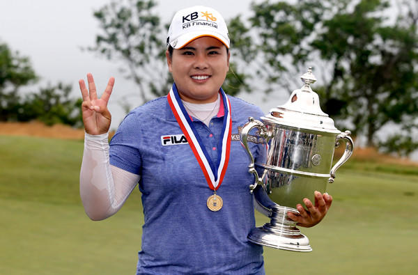 Inbee Park flashes three fingers as she poses with the winner's trophy at the U.S. Women's Open on Sunday at Sebonack Golf Club in Southampton, N.Y.