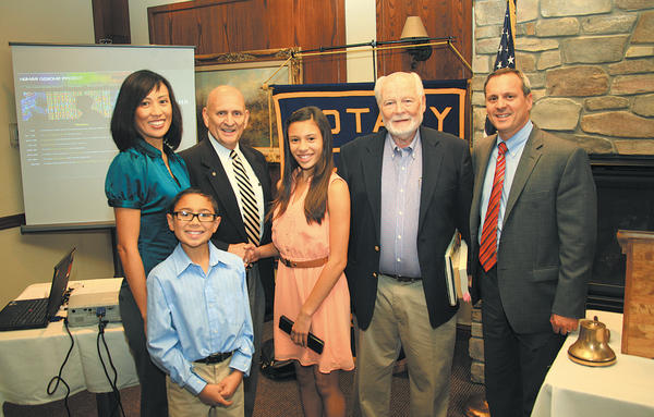 From left, Mimi Lising, Quinn Wandalowksis mother; Quinn's brother, Zach Wandalowski; Long Meadows Rotary Club President Ron Bowers; Quinn Wandalowski; Human Genome Mapper Dr. Dave Smith; and Quinn's father, Jay Wandalowski.
