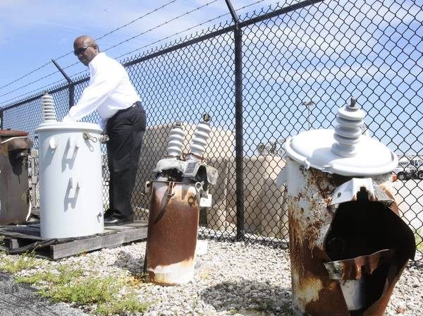 Duke Energy Supervisor Tony Doby recently checks out transformers that have failed in the past. (George Skene/Orlando Sentinel)