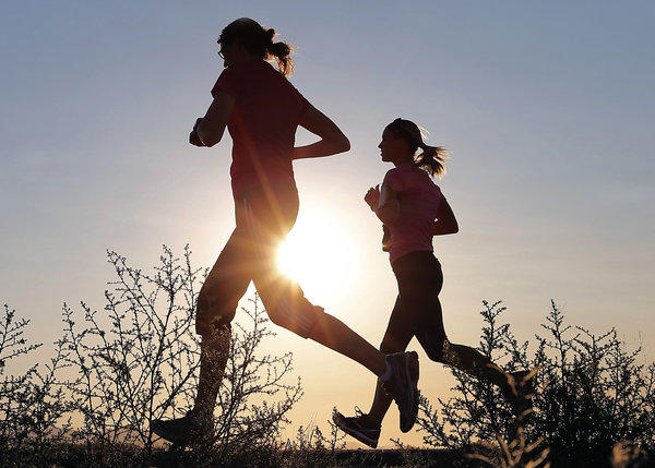 Runners in Mesa, Ariz. Six runners were hospitalized for heat-related conditions at a half marathon in Pasadena on Sunday amid record-breaking temperatures.