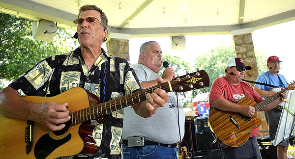 Men In Black perform Sunday at a Christian music festival at Shafer Park in Boonsboro. Members are, from left: Terry Worley, Arnold Martin, Drew Hawes, and Steve DeFreytas.