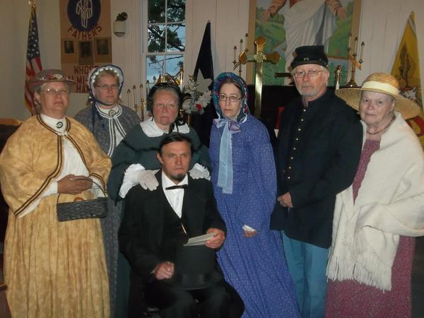 Re-enactors from left: Sharon Harkcom, Daryl Reed, Linda Marker, Ralph Lincoln (seated), Betsy Nightingale, Tim and Judy Bell will tell the compelling story of the Battle of Gettysburg during a 150th anniversary remembrance service at 7 p.m. Wednesday at Mount Union Church in Upper Turkeyfoot Township. The event will serve as a fundraiser for the historic church built in 1861. The church now serves as a home for re-enactment groups and special services.