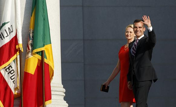 Mayor Eric Garcetti and his wife, Amy Wakeland, are introduced during his inauguration ceremony on the steps of City Hall in downtown Los Angeles.