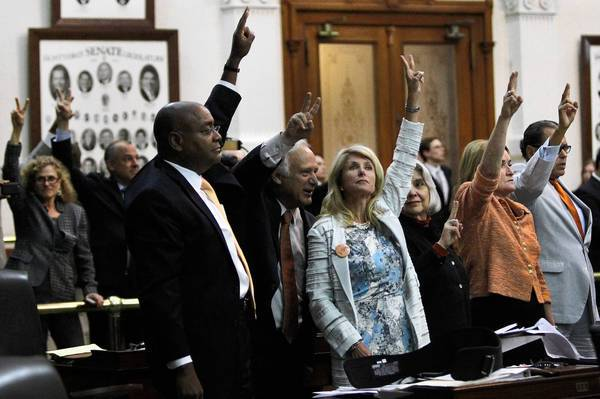 Texas state Sen. Wendy Davis, center, led a marathon filibuster last week to stop a sweeping bill to restrict abortion. Lawmakers will return Monday to consider the bill again.