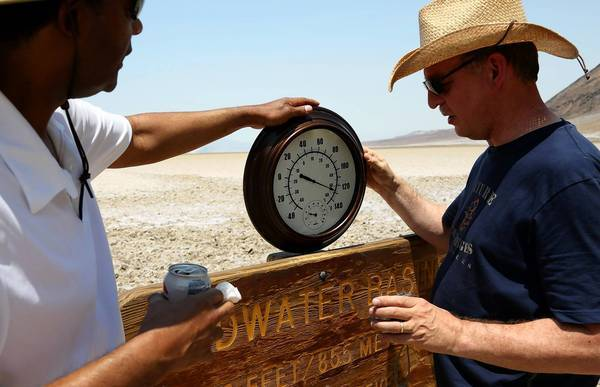 Randy Thomas of Vacaville, left, with Andreas Kinnen of Germany, brought his own thermometer to Badwater Basin in Death Valley.