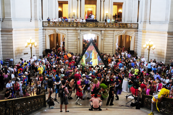 Parade attendees gather in the City Hall rotunda during the San Francisco Pride Celebration and Parade VIP Party in downtown San Francisco.