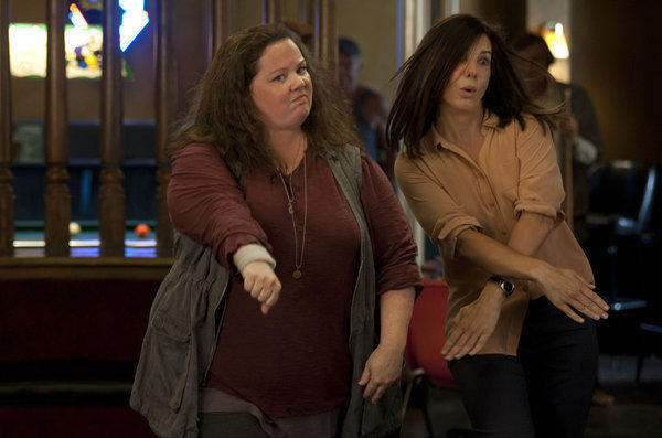 "Melissa McCarthy and Sandra Bullock in a scene from ""The Heat."""