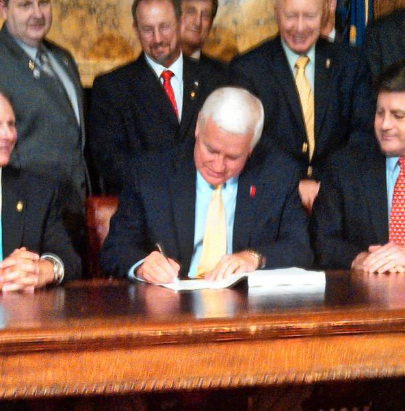 Gov. Tom Corbett signs the $28.3 billion state budget into law at 10:15 p.m. Sunday.