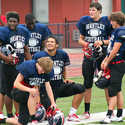 Lake Brantley defensive tackle Joey Grant (middle, one knee) holds court with his defensive cronies.