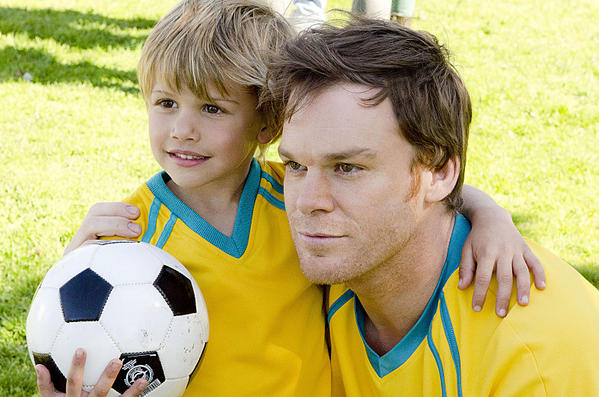 "Michael C. Hall (left) as Dexter Morgan and Jadon Wells as Harrison in ""Dexter."""