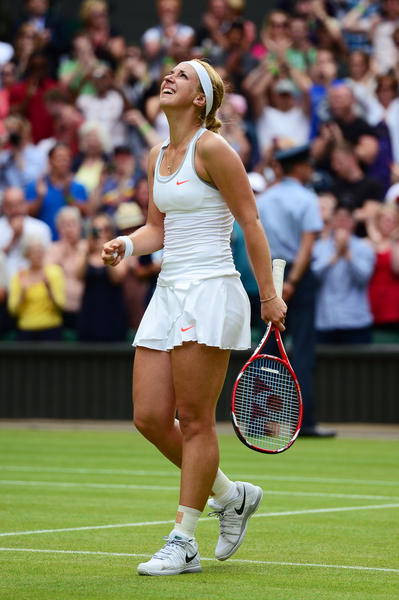 LONDON, ENGLAND - JULY 01: Sabine Lisicki of Germany celebrates victory during her Ladies' Singles fourth round match against Serena Williams of United States of America on day seven of the Wimbledon Lawn Tennis Championships at the All England Lawn Tennis and Croquet Club on July 1, 2013 in London, England. (Photo by Mike Hewitt/Getty Images) ORG XMIT: 168810652