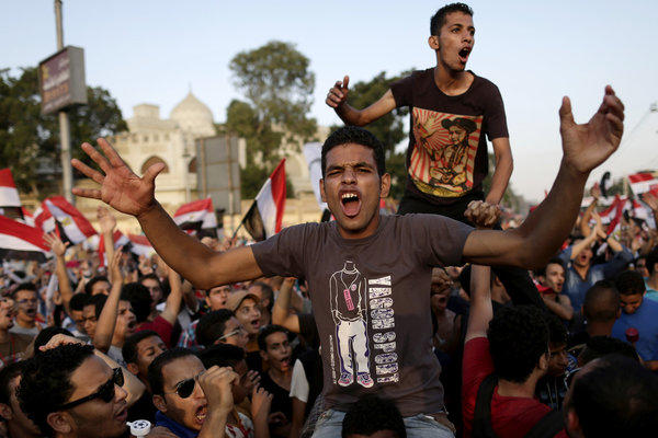 Opponents of Egyptian President Mohamed Morsi chant slogans during a protest outside the presidential palace in Cairo on Monday.