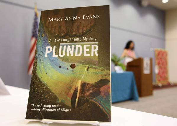"Award-winning author Mary Anna Evans discusses her archaeological mystery series featuring Faye Longchamps and her newest book, ""Plunder"", during a program at the Leesburg library on Tuesday, June 25, 2013."