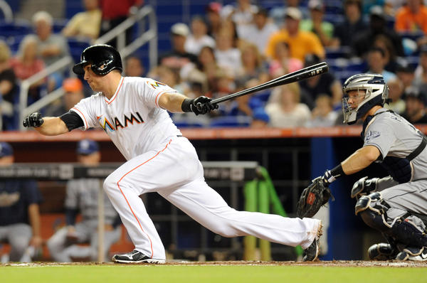 Jun 29, 2013; Miami, FL, USA; Miami Marlins catcher Jeff Mathis (6) connects for a two run RBI single during the fourth inning against the San Diego Padres at Marlins Park. Mandatory Credit: Steve Mitchell-USA TODAY Sports ORG XMIT: USATSI-122736