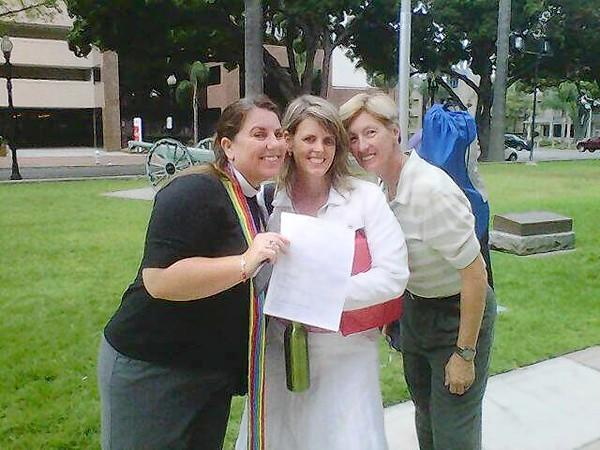 The Rev. Sarah Halverson holds the official marriage license for Jan Mabie and Beth Syverson at the Santa Ana courthouse on Monday.