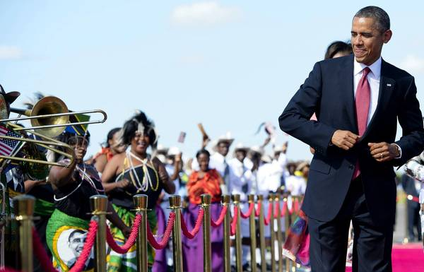 President Obama dances to music on arrival at the airport in Dar es Salaam, Tanzania. Tanzanians gave Obama his biggest reception yet on the final leg of his three-nation African tour.