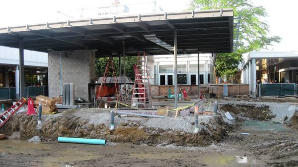 The common areas at Oak Brook Center are being renovated to include a glass pavilion that will have a fireplace and serve as a warming area.