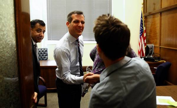 "On his first day on the job, Los Angeles Mayor Eric Garcetti meets with Hollywood resident Michael Konowitz in his office at City Hall. Konowitz spoke out against the city's recent crackdown on Lyft, a ride-sharing service opposed by cab companies. ""It was amazing,"" he said. ""I wasn't actually expecting to meet with the mayor himself. I was expecting to get a staff member."""