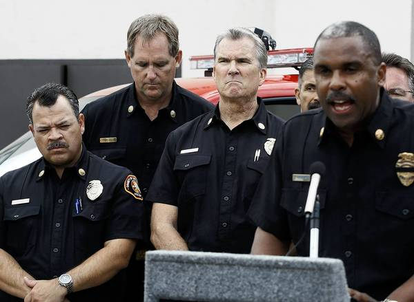 Los Angeles County Fire Chief Daryl Osby, right, talks about Kevin Woyjeck during a press conference Monday. Woyjeck's father, Joe, is a Los Angeles County fire captain.
