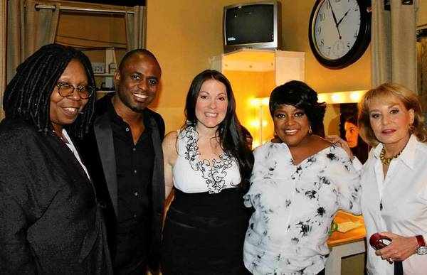 Rebecca Riddle of Easton, center, backstage with 'The View' co-hosts (from left) Whoopi Goldberg, Wayne Brady (a guest co-host), Sherri Shepherd and Barbara Walters.