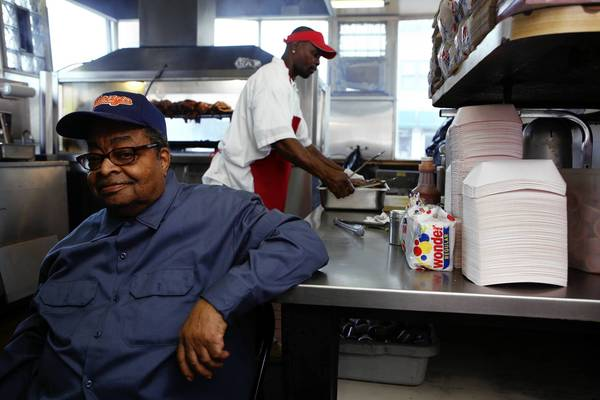 "James ""Lem"" Lemon, left, and Donnell Walker in the kitchen at Lem's BBQ House."