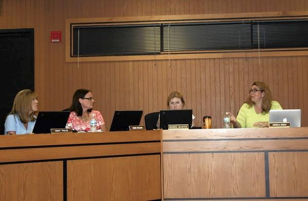 District 33C Board President Angela Adolf, far right, and board member Cindy Polke, far left, exchange words during a meeting June 26. The meeting featured tense debate over whether Polke can remain on the board after accepting an appointment to the Homer Glen Plan Commission.