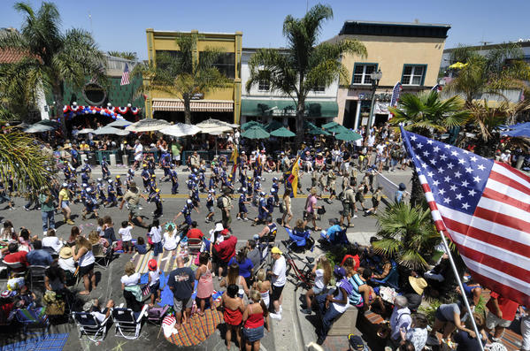 Members of the Pacifica District Cub Scouts and Boy Scouts of America march down Main Street in downtown Huntington Beach during the 2011 Huntington Beach Fourth of July Parade.