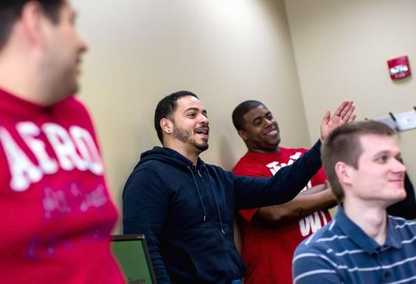 Carlos Santiago, an Army veteran, talks during a meeting of Warriors to Scholars group at Robert Morris University in Chicago. The group is a new resource to help student veterans as they start or resume their higher education.