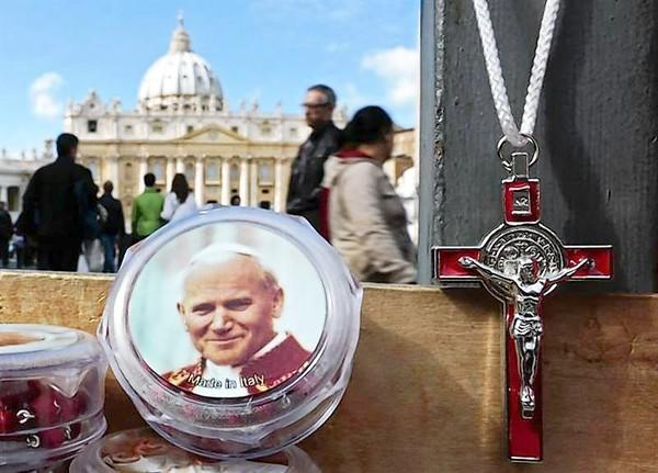 A picture of the late Pope John Paul II is seen on a rosary, for sale in Saint Peter's Square.